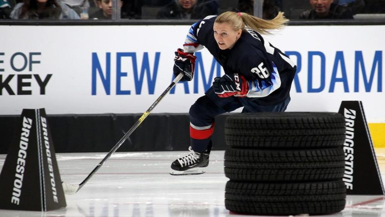 Female hockey player skating